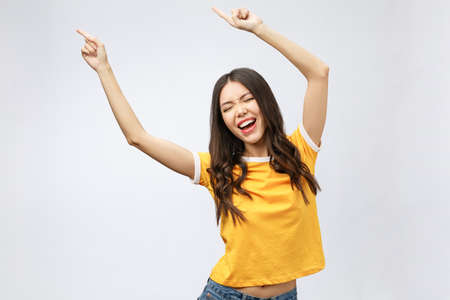 Asian women happiness hand up with winning or success something.