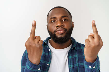 Winning success happy afro man businessman celebrating successful deal . afro-american male model showing the middle finger. Stock Photo