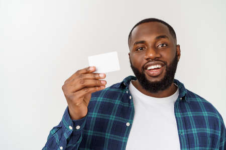 Business Concept - Happy handsome professional african american businessman giving name card to client