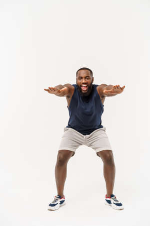 African sport man exercising and stretching on white background