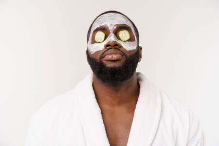 funny laughing man with mask leads healthy lifestyle, rejoicing at morning procedures. positive emotion in the morning. Stock Photo