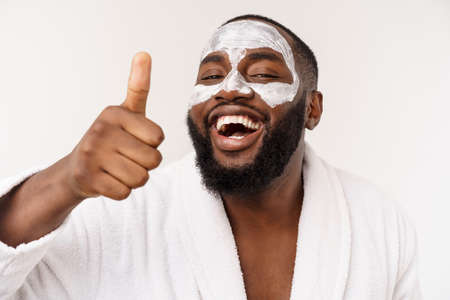funny laughing man with mask leads healthy lifestyle, rejoicing at morning procedures. positive emotion in the morning. Stock fotó