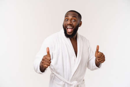 Portrait of happy afroamerican handsome bearded man laughing and showing thumb up gesture Stock Photo