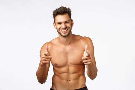 Handsome charming bearded young guy with naked torso, perfect body six-pack, finish workout, thanking instructor, show thumbs-up and smiling in approval, give positive feedback about gym, exercises