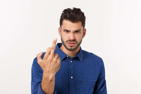 Handsome young man showing middle finger gesturing Screw you with white background.