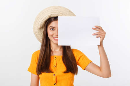 Happy business woman holding big white sign board. Gray wall back