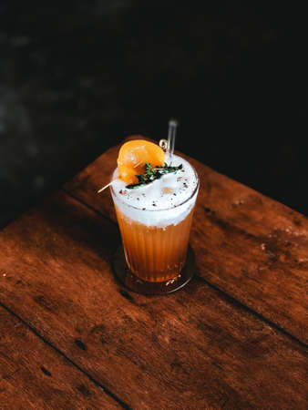 Peach tea with cream cheese in modern cafe
