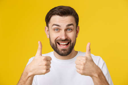 Portrait of caucasian man with big beard in white shirt. Bearded man shows thumbs up