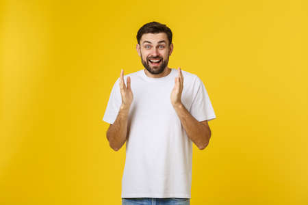 Young handsome elegant man over isolated background Clapping and applauding happy and joyful, smiling proud hands together.