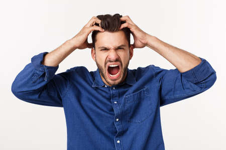 young office worker mad by stress screaming isolated on white.