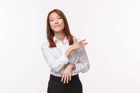 Easy. Carefree and unbothered asian woman professional, brush her shoulders off with pleased relaxed expression, finished project as say no big deal, achieve success easily, white background