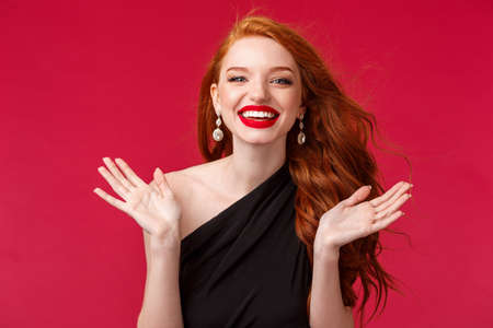 Makeup, beauty and women concept. Close-up portrait of excited, enthusiastic and happy young redhead woman attend stunning performance of artist, clap hands and smiling pleased