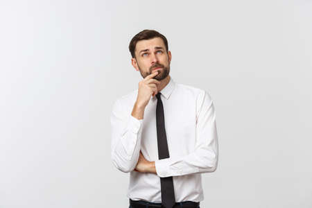 Thinking man isolated on white background. Closeup portrait of a casual young pensive businessman looking up at copyspace. Caucasian male model