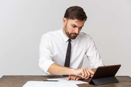 A view of a busy businessman signing a document in the office against white background Stock fotó
