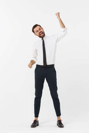 full-length portrait of happy businessman in formal wear with raising hands up. isolated on white background.