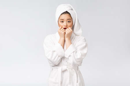 Spa skincare beauty Asian woman drying hair with towel on head after shower treatment. Beautiful multiracial young girl touching soft skin