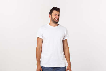 Close up portrait of disappointed stressed bearded young man in shirt over white background.