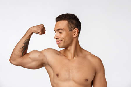 Portrait of a muscular african american man with no shirt. Isolated over white background.