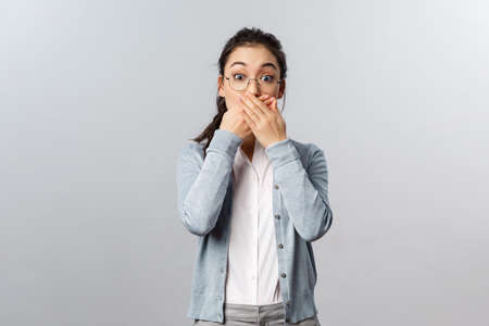 People, emotions and lifestyle concept. Oh my gosh. Portrait of speechless, startled cute asian girl gasping in awe, found out somoeone secret, react shocked, stare camera impressed