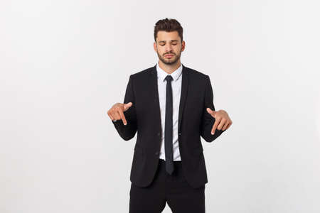 Business Concept: Portrait handsome young businessman point finger on side to empty copy space. Isolated over white background