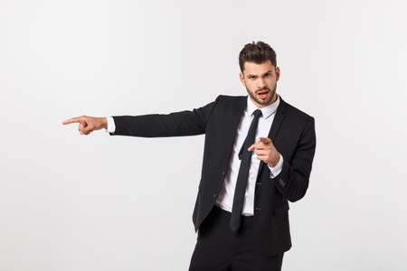 Portrait businessman angry and pointing finger at you over isolated white background