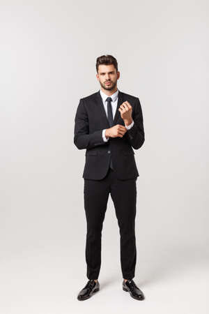Photo of an attractive businessman posting over a white background.