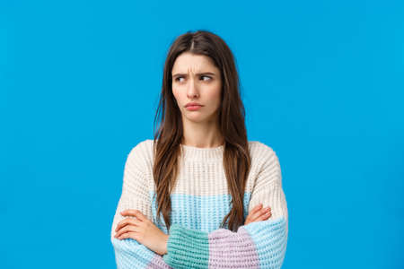 Waist-up portrait skeptical and displeased, gloomy offended girl sulking, feeling angry on boyfriend, cross hands over chest defensive, frowning and looking left with condemn, being insulted