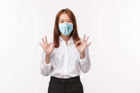 Relax, everything okay. Cheerful and carefree asian woman say no problem, make ok gesture and smiling, assure everything done, deal signed, guarantee great service and quality, white background