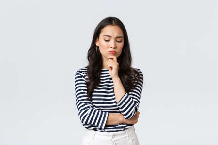 Lifestyle, people emotions and casual concept. Thoughtful troubled businesswoman thinking. Girl searching solution looking down pondering, making difficult choice