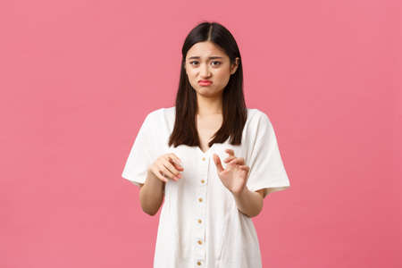 Beauty, people emotions and summer leisure and vacation concept. Disgusting stay away from me. Picky reluctant asian girl grimacing from aversion, gesturing as touching something nasty