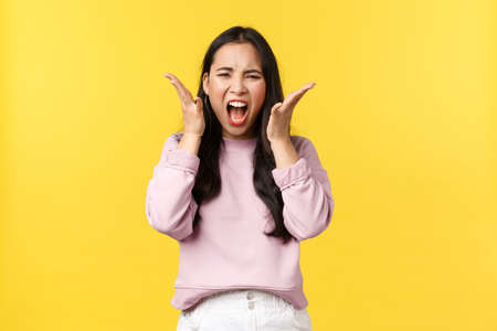 Lifestyle, emotions and advertisement concept. Angry distressed asian woman screaming hateful and outraged, feeling overwhelmed over bad news, reacting to awful situation, feel mad Reklamní fotografie