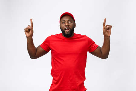 African american man over isolated background surprised with an idea or question pointing finger with surprise face. Stock Photo