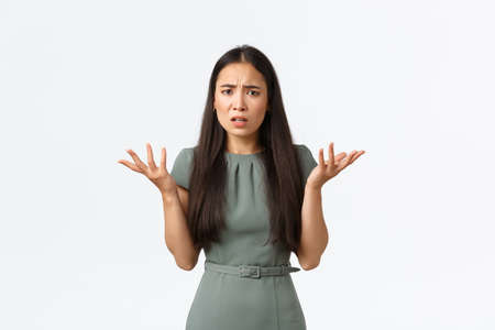Small business owners, startup and work from home concept. Whats problem. Confused and annoyed asian woman cant understand what happened, shrugging and raising hands in dismay, frowning perplexed