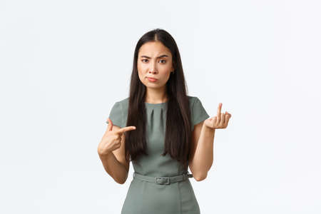 Small business owners, women entrepreneurs concept. Fed up and annoyed asian girlfriend having argument with boyfriend about wedding, pointing at finger without ring, complaining Foto de archivo