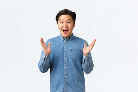 Happy proud and pleased asian male clap hands. Cheerful surprised guy applausing and congratulating with achievement, praising great work, saying well done to coworker, white background