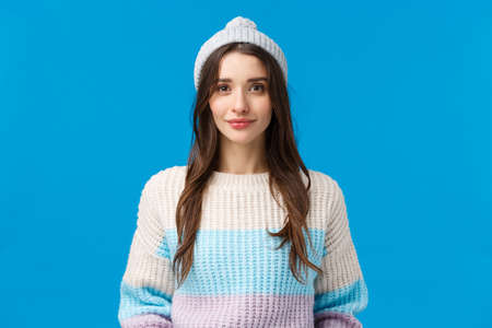 Waist-up portrait determined cute brunette female student full of aspirations and hopes for winter holidays season, wearing hat and sweater, smiling camera, express happiness and cuteness