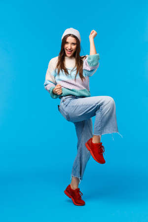 Full-length vertical portrait confident and happy, triumphing lucky woman won prize on lottery, winter holidays office party, raise on foot and fist pump, celebrating victory, say yes congrats