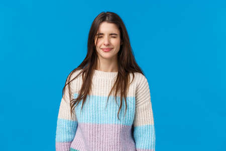 Waist-up portrait sobbing upset, timid and cute brunette girlfriend whining and complaining bad boyfriend forgot valentines day, crying, close eyes sulking feeling unwell, blue background