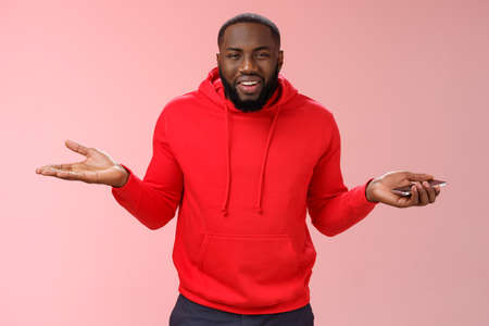 Who cares. Portrait indifferent unbothered chill good-looking african-american guy shrugging hands raised sideways clueless careless gesture look confused cannot get clue holding smartphone