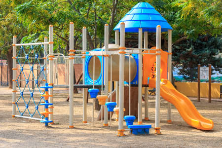 climbing frames: Shildren playground Multi - Unit with swings, agility equipment, slide and challenge net Stock Photo
