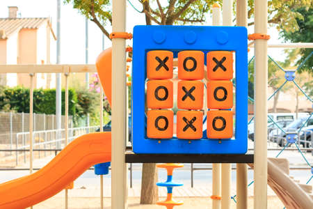 organized unit: oughts and crosses game at childrens playground