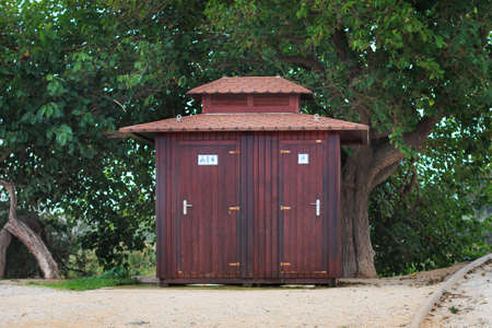 public toilet: Wooden public toilet among trees