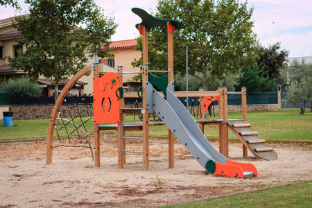 Children playground Multi - Unit with swings, see saw, springers, agility equipment, slide and sand pit Stock Photo