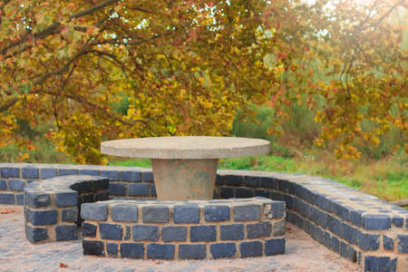 secluded: Picnic stone table in a secluded area for rest and relaxation Stock Photo