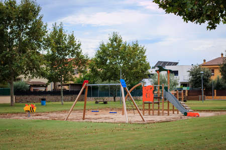 organized unit: Children playground Multi - Unit with swings, see saw, springers, agility equipment, slide and sand pit Stock Photo