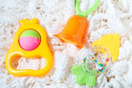 Newborn set of toys of teether and colorful rattles Stock Photo