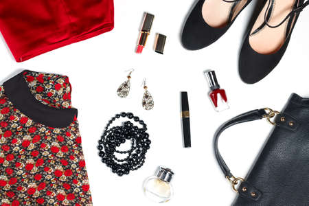 leather bag: Female clothes and look essentials - silk blouse, red skirt, black high heels, black leather bag, red lipstick, perfume Stock Photo
