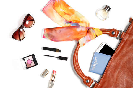 leather bag: Female bag things - leather bag, makeup items, smartphone, perfume, silk scarf, isolated on white background Stock Photo