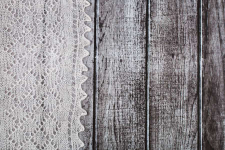 downy: Delicate crocheted handmade woolen downy material over rustic wooden background Stock Photo