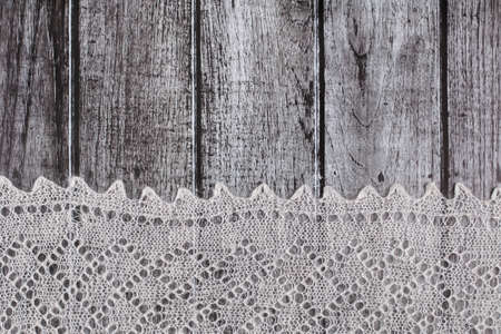 downy: Delicate crocheted woolen downy material over rustic wooden background